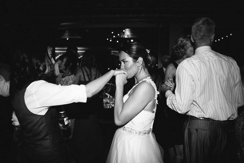 couples photos bride kisses