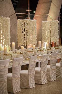 chair covers new year how to hang a hammock glamorous 39 s eve wedding at science museum in dallas chandelier of flower petals on strings ruched white