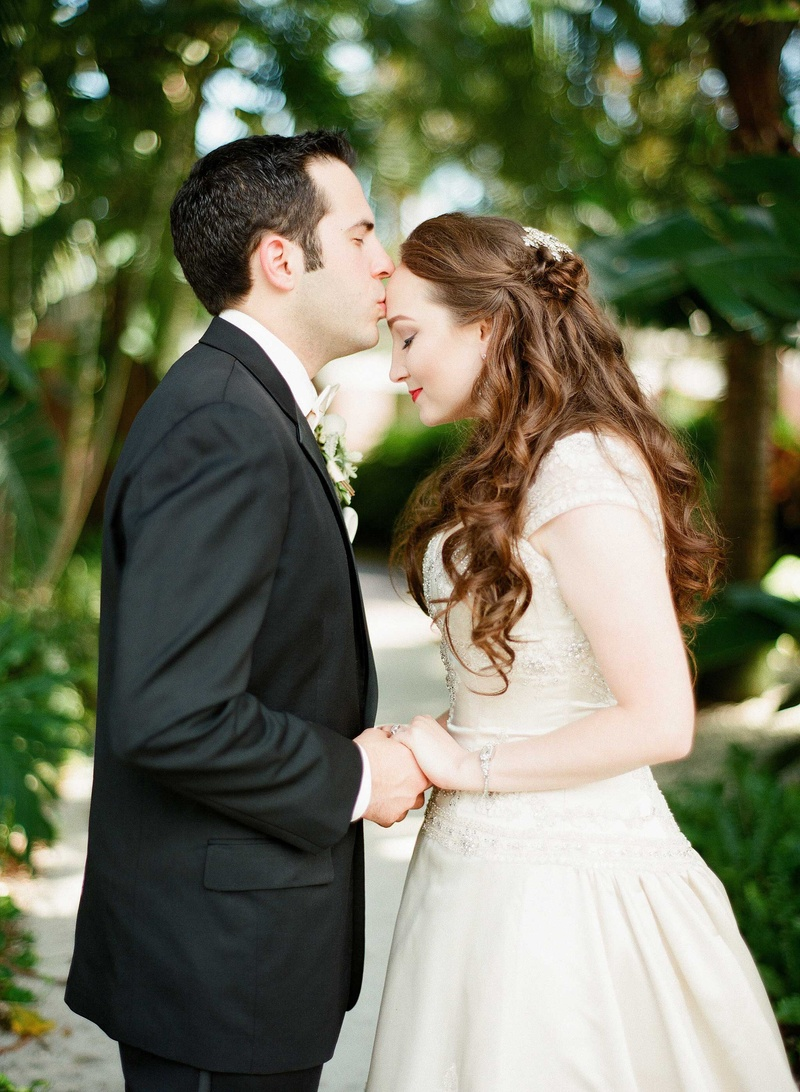 couples photos groom holds