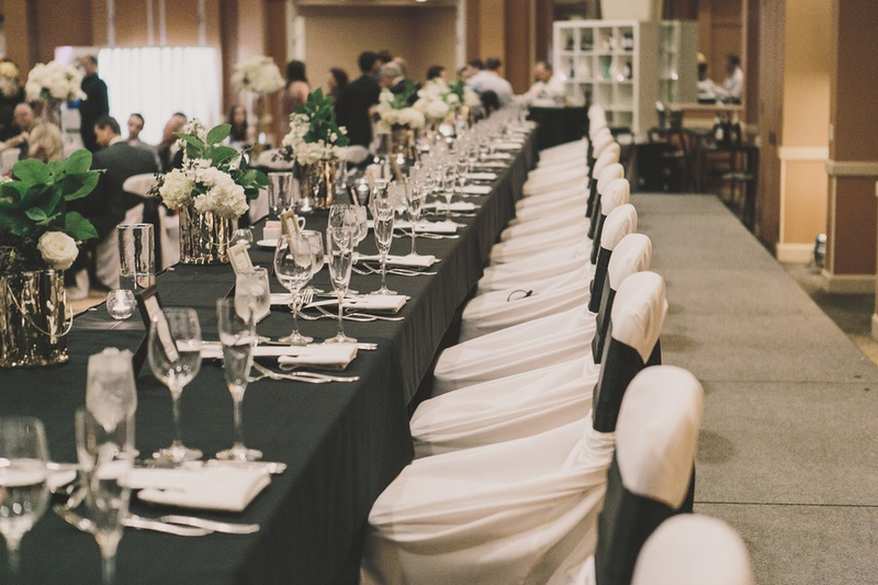 cheap black chair covers for sale anti gravity costco reception decor photos white inside weddings long head table surrounded by and chairs