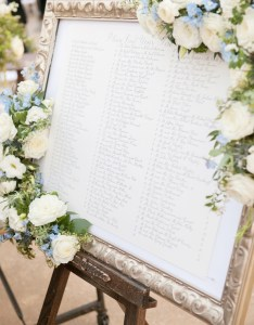 Table assignments in gold frame adorned with flowers also invitations  more photos framed seating chart inside weddings rh insideweddings