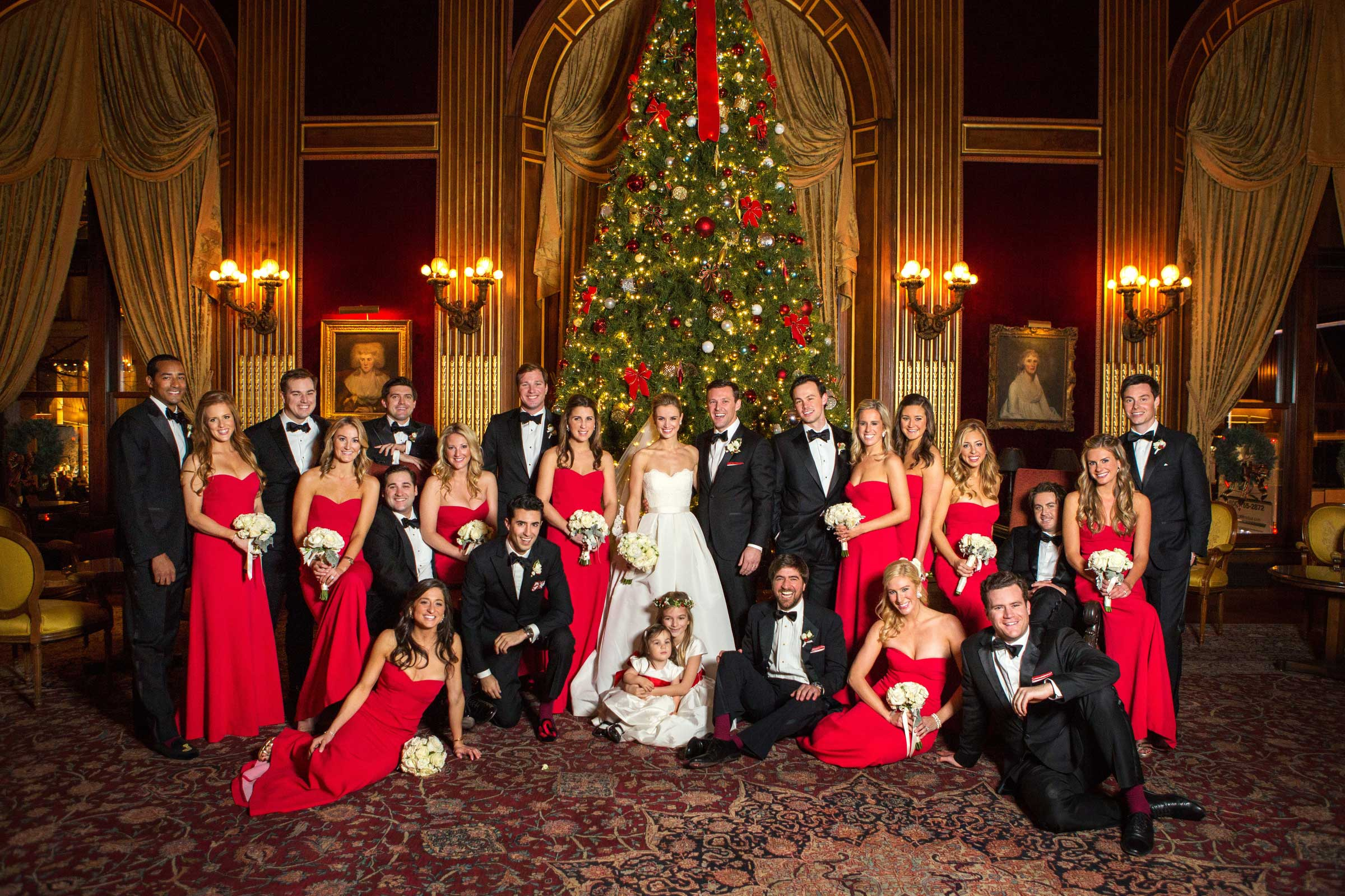 Festive dcor for weddings with a holiday or christmas theme christmas theme wedding party with red bridesmaid dresses ombrellifo Images
