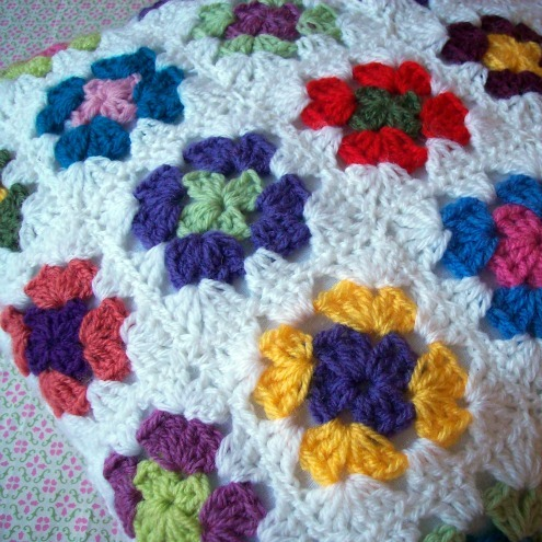 A crochet cushion cover of the granny variety £20.70