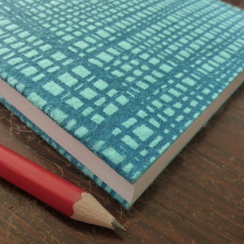 weave - screenprinted felt sketchbook in teal on turquoise