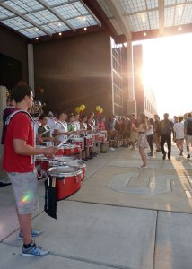 Schaumburg High School students enter the building on the first day of school, and are greeted by the school band.