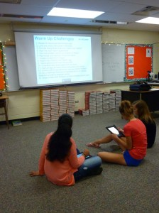 Students work in groups to familiarize themselves with their iPad devices.