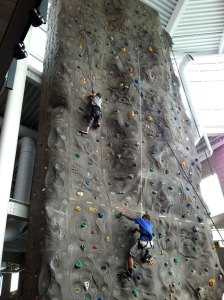 iCompete students participate in a rock climbing wall activity.