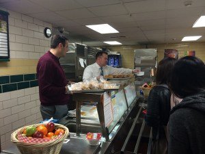 Fred High School Principal Kurt Tenopir (left) and Assistant Principal Eric Dolen (right) serve complimentary breakfast during the school's Breakfast with the Principal event.