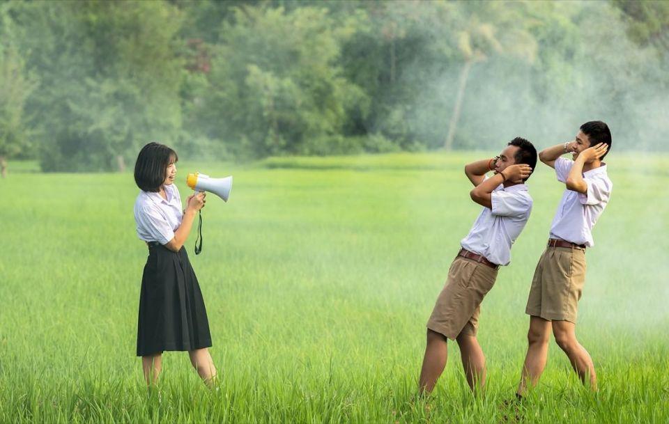 Girl Holding Megaphone Two Boys Grass Field | Photo