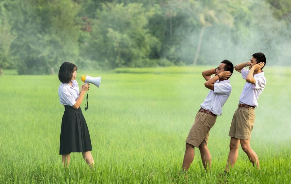 Girl Holding Megaphone Two Boys Grass Field | Photo