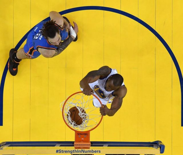 Andre Iguodala 9 Of The Golden State Warriors Goes Up To Slam Dunk The Ball