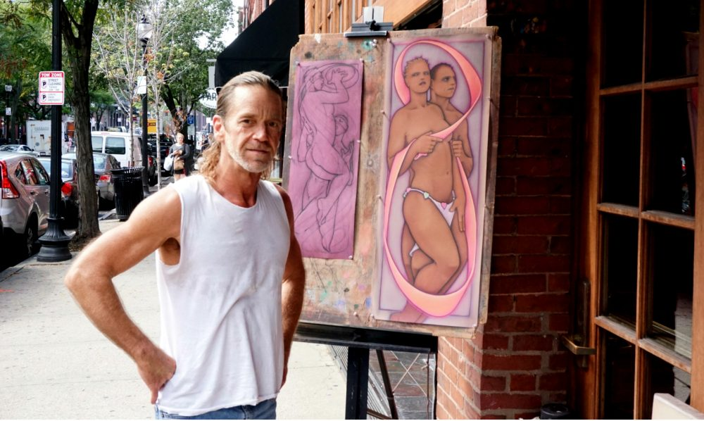 Artist Eric Kluin outside of the Newbury Street restaurant Sonsie. (Tom Meek for WBUR)