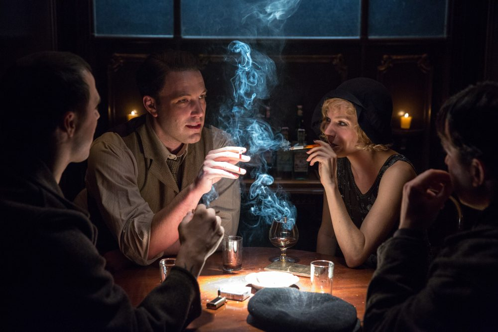 "Ben Affleck, as Joe Coughlin, and Sienna Miller, as Emma Gould, in ""Live By Night."" (Courtesy Warner Bros. Pictures)"