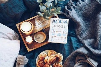 """A typical """"hygge"""" scene, with warm pastries, soft lighting and a copy of Meik Wiking's """"Little Book Of Hygge."""" (Valerie_bd/Instagram)"""