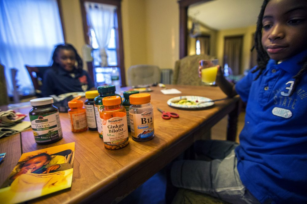 Each morning Beverly Hilaire gives both Stephen and Harrison a cocktail of over-the-counter supplements to help them with clarity. (Jesse Costa/WBUR)