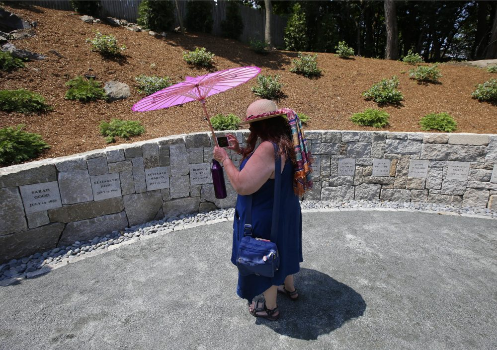 Karla Hailer, a fifth grade teacher from Situate, makes a video of the Proctor's Ledge memorial. (Stephan Savoia/AP)