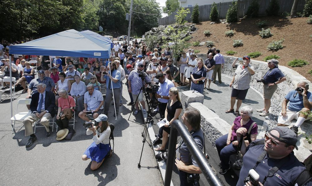 Area residents attend a memorial dedication at Proctor's Ledge in Salem Wednesday.(Stephan Savoia/AP)