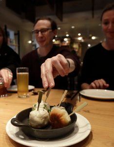 Mike hardin center reaches for  dumpling while dining with others taking tour also soleil ho continues making mark in food journalism as san francisco rh wbur