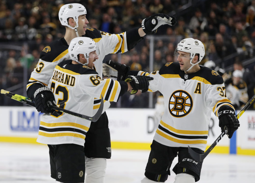 Boston Bruins Left Wing Brad Marchand 63 Celebrates With Teammates Zdeno Chara Back