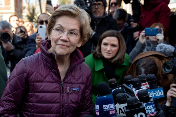 Sen. Elizabeth Warren talks to the press after announcing that she was dropping out of the Democratic presidential race in March. (Robin Lubbock/WBUR)