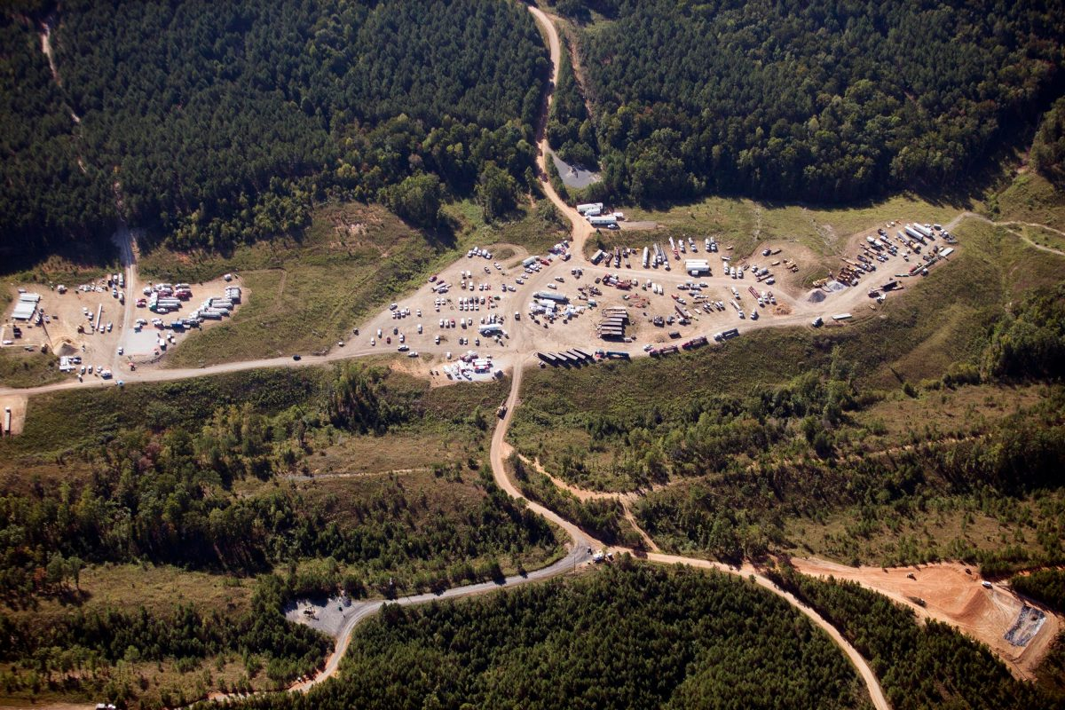 Vehicles are seen near Colonial Pipeline in Helena, Ala. on Sept. 10, 2016. A major pipeline that transports fuels along the East Coast says it had to stop operations because it was the victim of a cyberattack. (Brynn Anderson/AP)