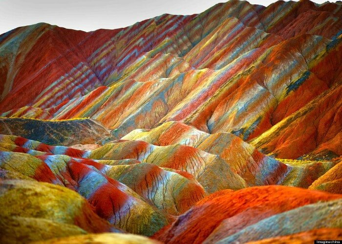Watch diferent shades of colors at this rainbow mountain