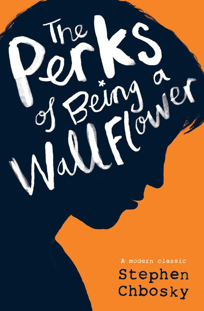 Image result for person reading perks of being a wallflower book