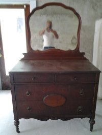 I Have An Antique Dresser That Has Wooden Wheels, A Mirror