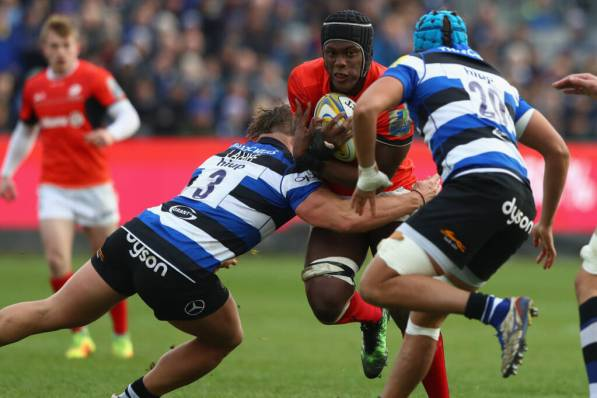 BATH, ENGLAND - DECEMBER 03:  Maro Itoje of  Saracens is tackled by Max Lahiff of Bath during the Aviva Premiership match between Bath Rugby and Saracens at the Recreation Ground on December 3, 2016 in Bath, England.  (Photo by Michael Steele/Getty Images)