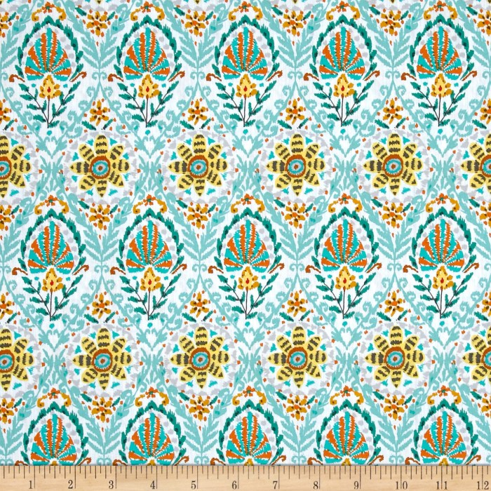 Designed by Dena Designs for Free Spirit Fabrics this cotton print is perfect for apparel quilting and home decor accents. Colors include shades of jade yellow orange grey dark chocolate and white.
