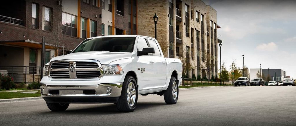 2019 Ram 1500 Classic in white parked outside a brick building