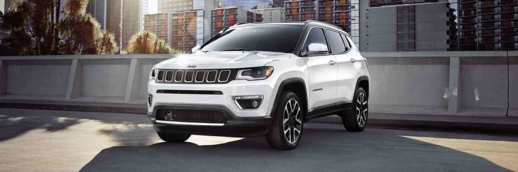 A white Jeep Compass parked on the road
