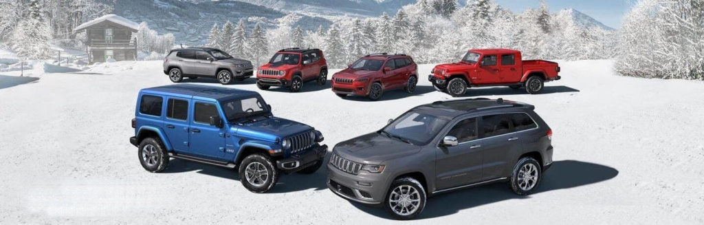 2020 Jeep Lineup of vehicles in the snow including the Cherokee, Renegade, Grand Cherokee, Gladiator, Wrangler, and Compass