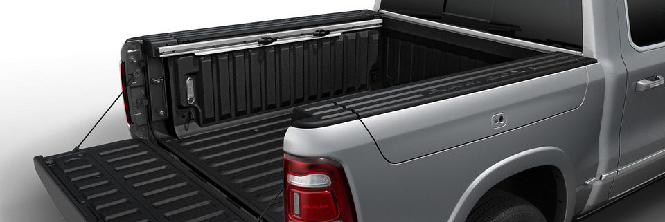 Side angle of 2020 Ram 1500 with box and tailgate open