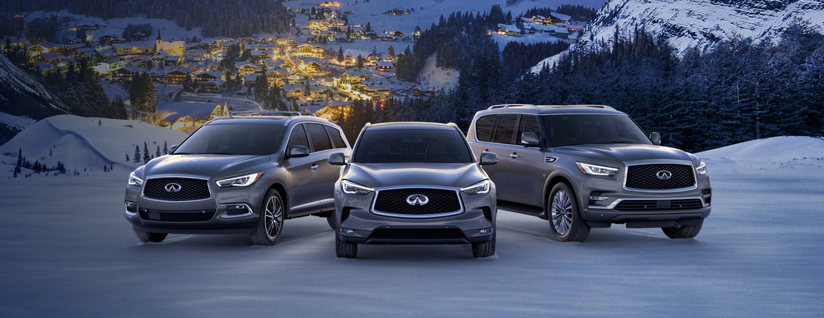 various infiniti models overlooking a mountainside town