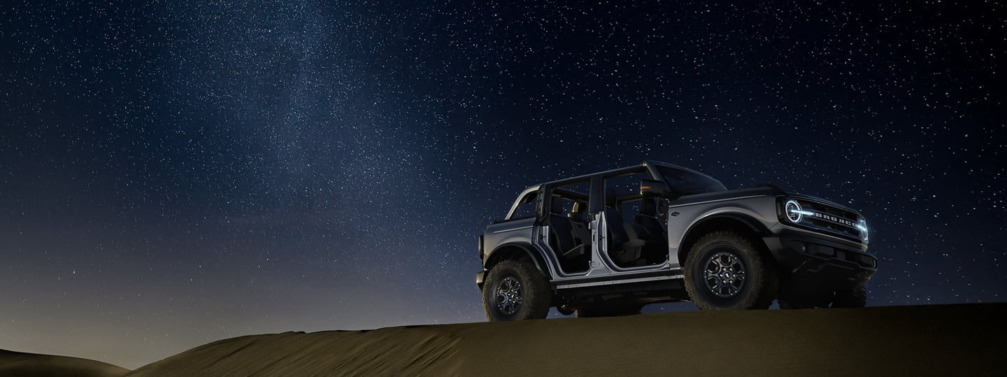 2021 Ford Bronco Parked On Desert Hill At Night