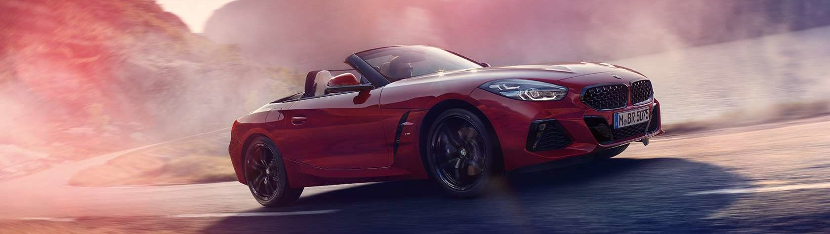 BMW Z4 driving on a dusty road