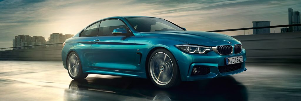 BMW 4 Series on an open industrial road