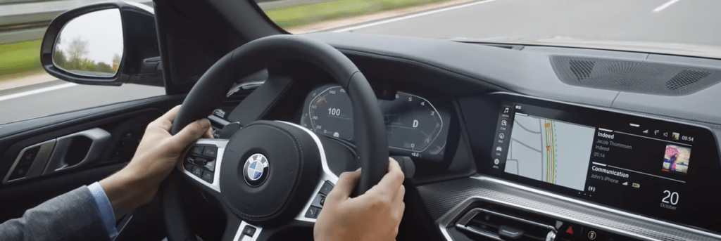 Interior of BMW front cabin with steering wheel and front dash