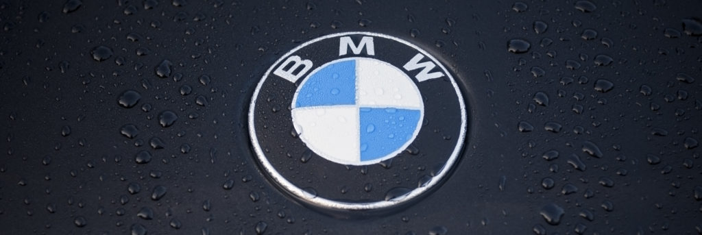 BMW logo with some rain drops around it