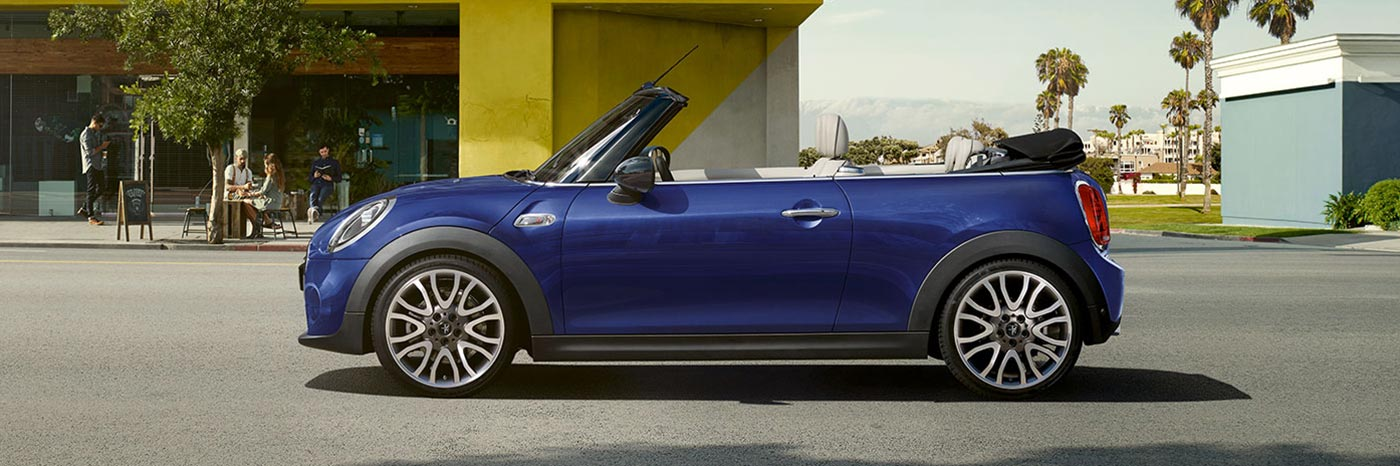 MINI Cooper Convertible side view with top down