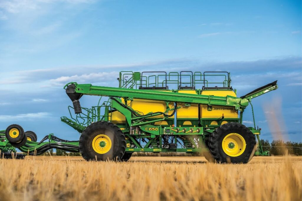 Side exterior view of the John Deere C650