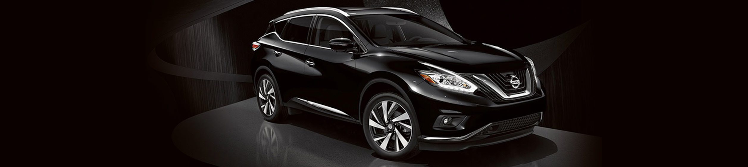 Nissan Murano on a dark background