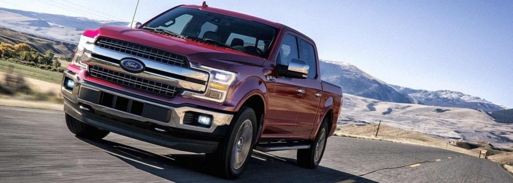 Red 2018 Ford F-150 Driving Down Road