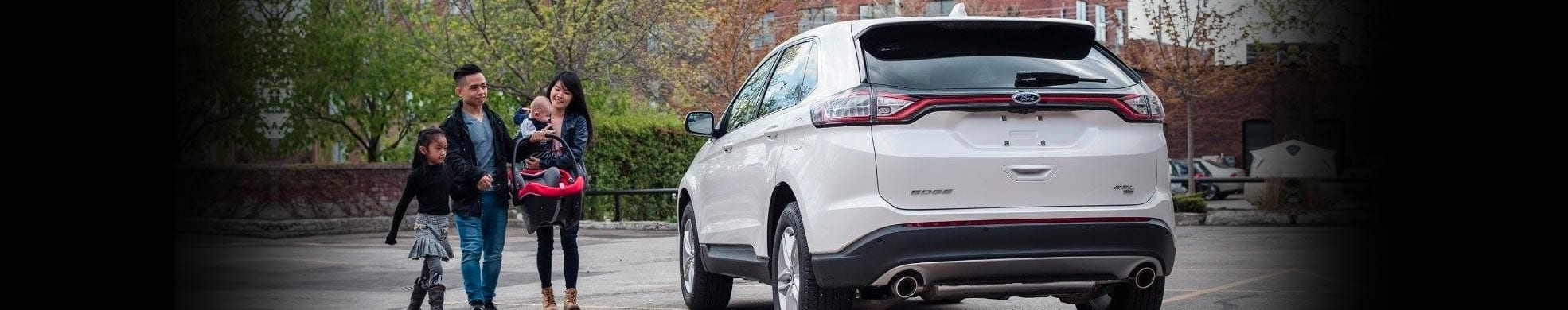 White Ford SUV Edge with family