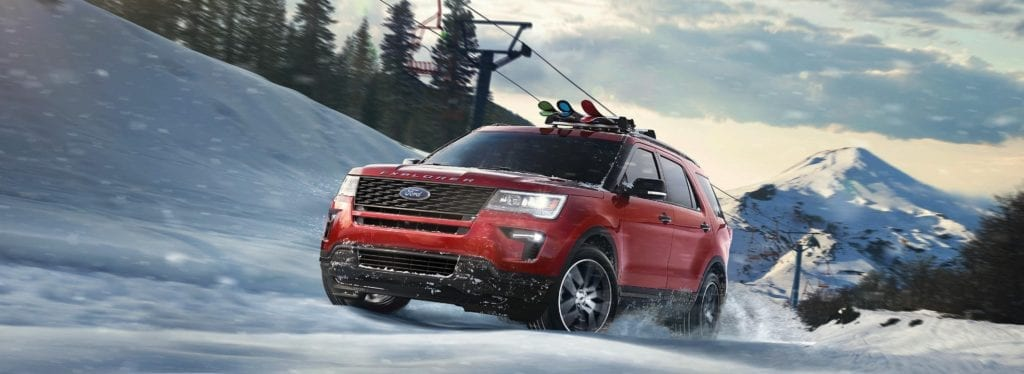 Ford explorer driving through snow