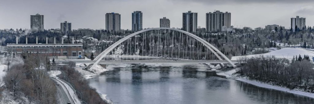 A winter view of the Edmonton River Valley, with the new Walterdale Bridge front and centre