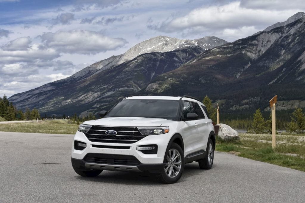 White 2020 Ford Explorer Parked In Front Of Mountains
