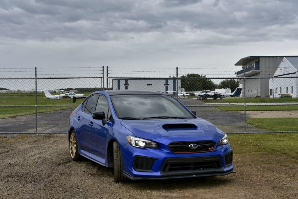 Subaru WRX STi Blue Parked Angle on Grass