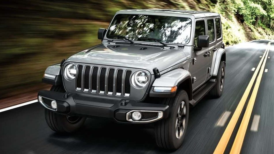 A 2018 Jeep® Wrangler Unlimited Sahara powers down a mountain highway